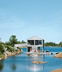 Floating House, Doug and Becca Worple's lake house in Ontario. Weathered cedar slats mark the facade.