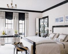 In this master bedroom designed by Brian McCarthy the ebonized-wood bed and upholstery fabric are by Ralph Lauren Home.