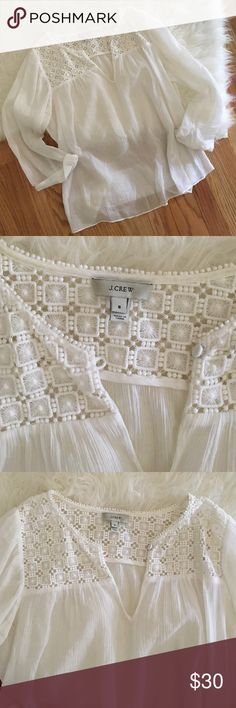 JCrew Sheer Lace Top The is a beautiful JCrew top! It's sheer, white with Lace detail on the top! Size 8. Great for dressing up or down! J. Crew Tops Blouses