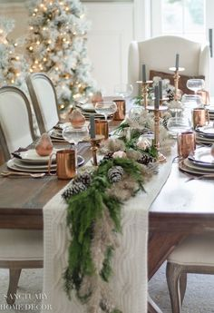 Yay! It's Christmas tablescape time! I do so love this time of year when we get to play with twinkly lights and sparkles and everything merry and bright. And, as always, I love setting a beautiful table. This year I decided on a neutral Christmas tablescape with copper accents and a green and platinum garland […] #christmastables Christmas Dining Table, Christmas Table Settings, Christmas Tablescapes, Farmhouse Christmas Decor, Rustic Christmas, Christmas Home, Holiday Tablescape, Christmas Ideas, Christmas Clock