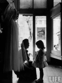 Woman Dress Shopping with Her Young Daughter 1953