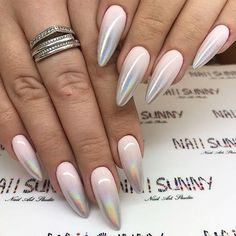 Silver french nail design for almond shape. Are you a fan of an almond nails shape? To tell the truth, we adore how feminine and soft this nail shape appears, making your fingers seem longer than they are. Today we will discuss which nail designs will work great for this nail shape. You will wish to try them all for sure! #naildesigns #almondnails #nailideas #almondshapednails
