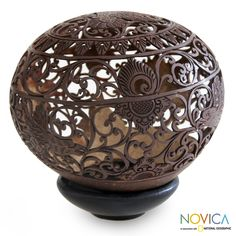 Eagles soar through the heavens in a sculpture with a beautiful expression of freedom. Keeping alive the artisan heritage of her late husband, Putra Suteja, Eka presents an intricately carved coconut shell sculpture on an albesia wood base.