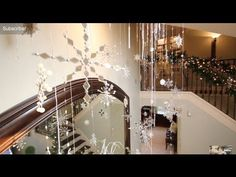 ▶ Christmas Decorating Snowflakes Falling Christmas decorations - YouTube  I would never staple gun to my ceiling or walls.  This could be improved upon.