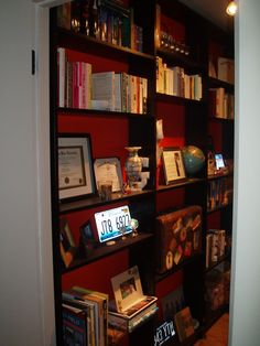 Hallway space becomes a library with built in shelving.