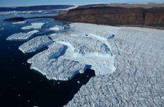 A glacier creates icebergs as it sinks into the sea, near Qaanaaq, Greenland, on July 30. (Yumi Nakayama)
