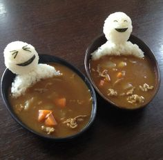 A fun way to serve soup.  Form sticky white rice into people, cut the facial expressions out of nori.