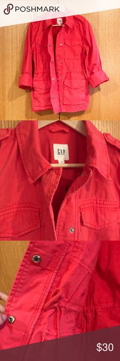 "Gap Utility Jacket Beautiful coral colored utility jacket from Gap. Hidden drawstring waist. Cuffs are adjustable, and sleeves can be worn down or rolled up. Snap closures. Four pockets in front. Women's size XSmall. 27"" length, 16"" between shoulder seams. Great lightweight jacket, with a loose fit and slightly-distressed relaxed look. Perfect for layering any season of the year. Very good used condition. GAP Jackets & Coats Utility Jackets"