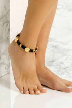 Handmade black leather anklet with 24k gold embellishments that don't tarnish with the sun. This unique and stylish piece matches perfectly with slip-on sandals. Wear it with cropped hemlines all summer long. Explore our collection of leather anklets, handcrafted in Athens, Greece, and add a boho-luxe touch to your summer outfit. For our jewelry, we use the same premium leather we built the sandals with, the finest materials and the impeccable local craftsmanship. Leo Zodiac Tattoos, Anklet Bracelet, Bracelets, Beaded Anklets, Summer Outfits Women, Casual Chic, Women Jewelry, Black Leather, Rings