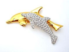 """Vintage Swarovski Crystal Double Dolphin Figural Brooch Signed Gold Plated Pin  This is a gold plated double dolphin brooch/pin with clear crystal stones.  It measures 2.5"""" by 1"""", signed Swarovski and in excellent condition. Jewelry & Watches, Vintage & Antique Jewelry, Costume"""