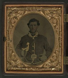 [Unidentified soldier in Confederate second lieutenant cavalry uniform with sheathed cavalry sword] (LOC) by The Library of Congress, via Flickr