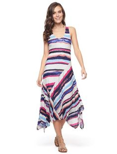 "Escape the winter blues in our Mirage Stripe Dress 	Bold, colorful abstract stripes  	Perfect with sandals or wedges 	Round neckline 	Sleeveless 	Handkercheif hem 	Lined 	Model is wearing size XS. She is 5'9"", 34-23-34, dress 2"