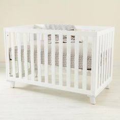 What's hot in nursery trends; soft base hues! Land of Nod White Crib pinned via CharlotteSmartyPants.com