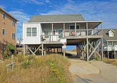 The comfort of a chic hotel will never be able to match the yesteryear character of The Gray House. Located at milepost 6 in Kill Devil Hills, this definitive classic bungalow boasts pet friendly oceanfront living you would expect along with direct beach access, 3 bedrooms with queen beds, and a tucked-away nook with 2 twins and an attic style loft complete with a-frame ceiling.