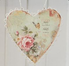 Love this sweet little distressed heart, shabby chic / cottage style - can see this with maybe scrapbook papers decoupaged onto painted, distressed wood, don't forget a nice quote, i'm seeing something else for the border, haven't decided what yet. torn muslin strip ribbon to hang? this is beautiful inspiration though. :)