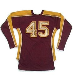 wonderful 1930's Antique Football Jersey. This exceptionally high quality jersey was made by the Rawlings Sporting Goods company. This eye catching, vintage football jersey consists of a maroon wool body with attractive gold, white and maroon striping and details. Also the number 45 is sewn on to the both the front and the back.  $375