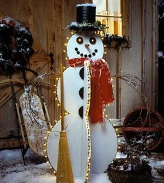 Light up the yard and the holiday season with this sturdy snowman's everlasting smile. Strings of Christmas-tree lights brighten his outlook, and a coffee-can top hat and a hand-me-down scarf add a joyful personality.