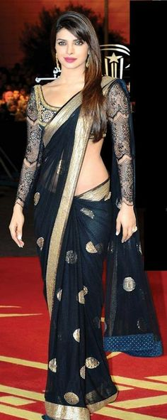 Priyanka Chopra wear black designer net saree at film festival.  #sarees #sari #black #indian #designer