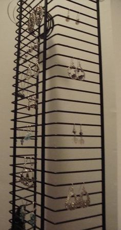 Use a wire DVD rack as a Jewelr Organizer - YAY..I see these at garage sales ALL the time