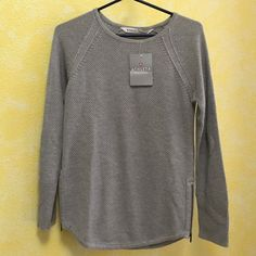 Athleta Varsity Sweater Side zips, crazy soft fabric, breathable, and comfortable! Cotton & Polyester. Semi-fitted, skims over body with room to layer. Open boatneck design, rib-knit trip at cuffs and hem, raglan sleeves give room to move. Athleta Sweaters Crew & Scoop Necks