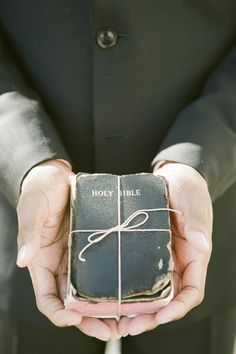 "The bride's family Bible served as the ring ""pillow"" at The Inn at Palmetto Bluff, a Montage Resort. Photo by Ashley Seawell, via Southern Weddings Magazine. Wedding Designer: Sage M."