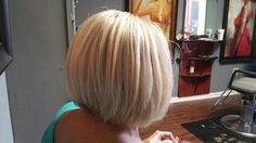 Beautiful blonde color using Swartzkoft to cover base then I added some highlights for some brighter blonde. Slightly inverted and stacked bob cut.