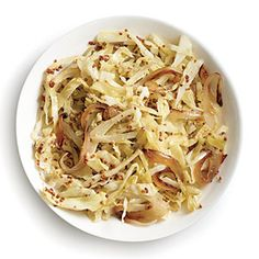 A little sautéed onion, cider vinegar, and whole-grain mustard make Cider-Braised Cabbage a fast and delicious side to add to your weeknight meals.