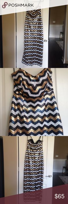 NWT Gianni Bini Long Black/White/Gold Sequin Dress This dress is gorgeous!!! You will sparkle when you wear this Gianni Bini dress. It is a size large and is NWT. Retail price is $129. Gianni Bini Dresses