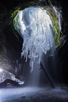 Water from Donut Falls seeps through a hole in the cave ceiling. The water freezes through the night and thaws through the day during winter.