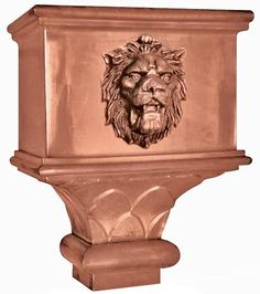 copper leader head - conductor head - hopper head with custom lion head design casting in copper pictured here