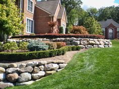 DeClark's Landscaping features lawn design with stone features and lawn maintenance in Macomb, Michigan.