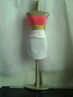 Harumika design #5: this design is a neon tube top with a gold shiny belt and a plain white skirt.