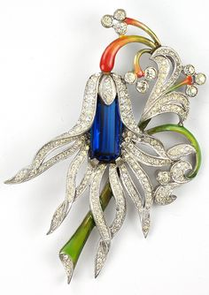 Pennino Pave Sapphire and Enamel Flower Pin. Before 1942.