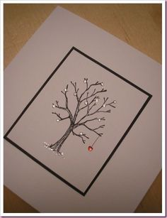 Take a bare tree stamp and add a few tiny clear gems, a tiny heart shaped gem and a bit of translucent glitter