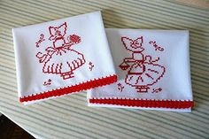 Red cross-stitch towel set with hand-crocheted trim