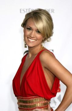 I love Carrie Underwood!!!!! She's absolutely Beautiful!!! For pregnant she looks amazing