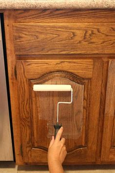 The Best Way to Paint Kitchen Cabinets (no Sanding!) Find out how the right tools, products and method can save you HOURS of time! Dark Wood Cabinets, Refacing Kitchen Cabinets, Painting Kitchen Cabinets, Kitchen Paint, Home Decor Kitchen, New Kitchen, Kitchen Ideas, Kitchen White, Cheap Kitchen