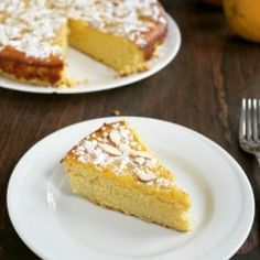 Rich dense cake that's decidedly tart from oranges that have been pureed whole in the batter alongside the pleasantly nutty taste of almonds. Just Desserts, Delicious Desserts, Sweet Desserts, Yummy Treats, Sweet Treats, Orange And Almond Cake, Cake Recipes, Dessert Recipes, Dessert Ideas