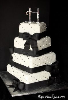 black and white square wedding cake with bows