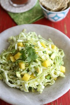 Sounds perfect for fish tacos!- Mexican Slaw Recipe with Mango, Avocado & Cumin Dressing for Cinco de Mayo by Cookin' Canuck. Mango Recipes, Slaw Recipes, Mexican Food Recipes, Vegetarian Recipes, Cooking Recipes, Healthy Recipes, Clean Eating, Healthy Eating, Summer Slaw