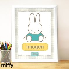 A delightful Personalised Miffy Gingham Large Name Frame. Suitable for girls or boys, this much loved children's character will make a focal point in the child's room or nursery. Personalise with their name to make a beautiful new baby gift or personalised christening present. The print comes in a white frame and measures approx 33x40cm.