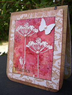 handmade card from Learning by Jacqueline.fr ...white silhouette floweres embossed on gorgeous background of pink alchol inks ... beautiful!!