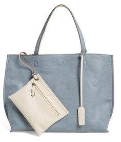 Blue leather tote bag and wristlet