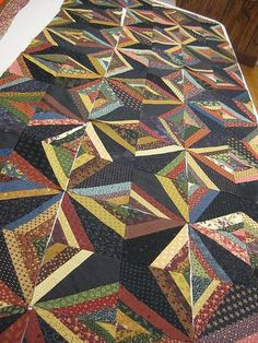 String Quilt....I like the dark kite shaped piece in one corner...It give a whole new look to this string quilt.