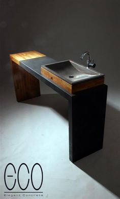 Concrete/wood countertop for sinks but needs a shelving addition to the middle to house the basket drawers