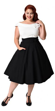 This stunning Colorblock Tippi Swing Dress has landed. And it looks like it's come straight from a bygone era, it's a flawless vintage inspired swing dress. This must have dress has an ivory white top with a fold over bateau neckline and faux button tab accent, complete with flattering underbust darting.