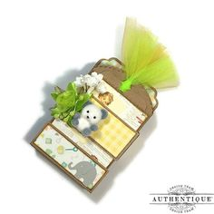 Authentique Paper. LC: Fold out mini tag album. Lots of goodness in a tiny space!