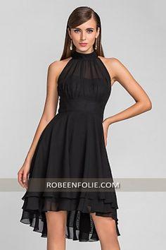 Ne ratez pas #les_moments importants de vos #cocktails avec cette #élégante #robe_de_cocktail #noire qui tombe aux longueurs asymétriques de #robe_en_folie