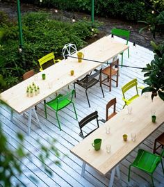 love this for the patio. very simple tables with a mix of outdoor chairs, very cool. if can find two of each kind, would be perfect and look intentional