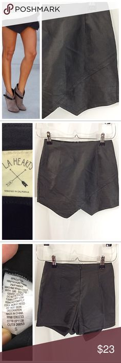 "Envelope Skort Trendy Chic black Skort with front envelope wrap styling. Back zipper closure. Jet black cotton fabric has polyurethane blend, giving a coated appearance; 2% spandex adds plenty stretch. Fitted size Small by LA Hearts; 12.5"" waist, 2.5"" inseam. EUC PacSun Shorts Skorts"